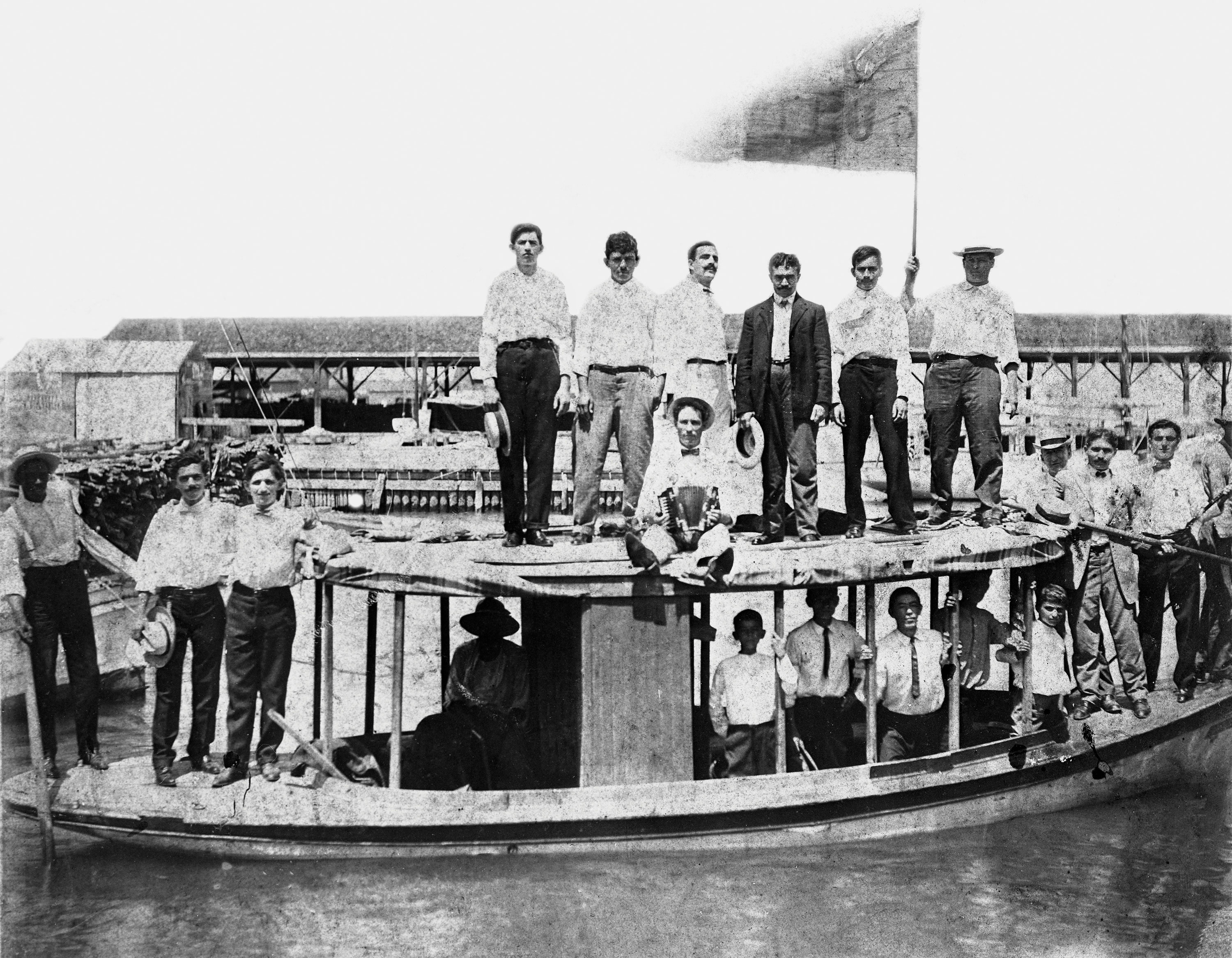 Cover image for Arlo Haskell's nonfiction book The Jews of Key West: Smugglers, Cigar Makers, and Revolutionaries (1823-1969), published in November 2017 by Sand Paper Press. Image shows the Key West, Florida, Young Men's Hebrew Association on a boat outing in 1908. (Black & white photonegative, 4 x 5 in. State Archives of Florida, Florida Memory.)